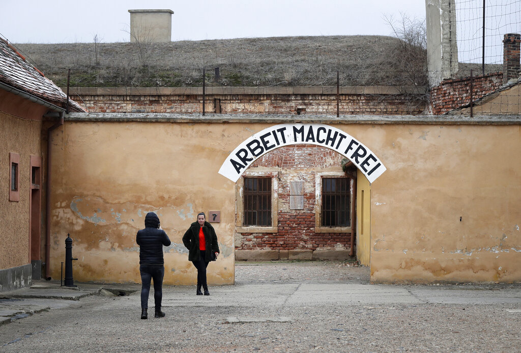 Visitors take photographs at the former Nazi concentration camp in Terezin, Czech Republic, Thursday, January 24, 2019. (AP Photo/Petr David Josek)