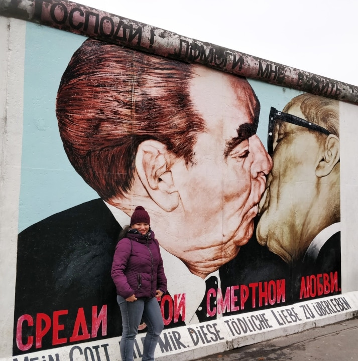 Painted by Russian artist Dmitri Wrubel, The Fraternal Kiss depicts the infamous embrace between Soviet leader Leonid Brezhnev and East German President Erich Honecker. It took place in 1979 in honour of the 30th anniversary of the German Demonstrated Republic, or East Germany. The slogan under the painting reads 'My God, Help Me to Survive This Deadly Love'.