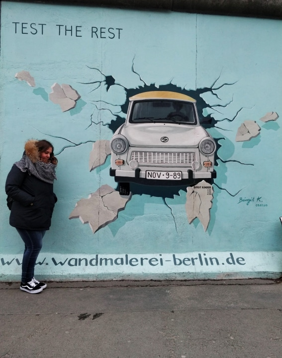 A symbol of the Communist East Germany, the Trabant car was used as an escape vehicle to go over the Berlin wall. This painting by Birgit Kinder is a depiction of those times.