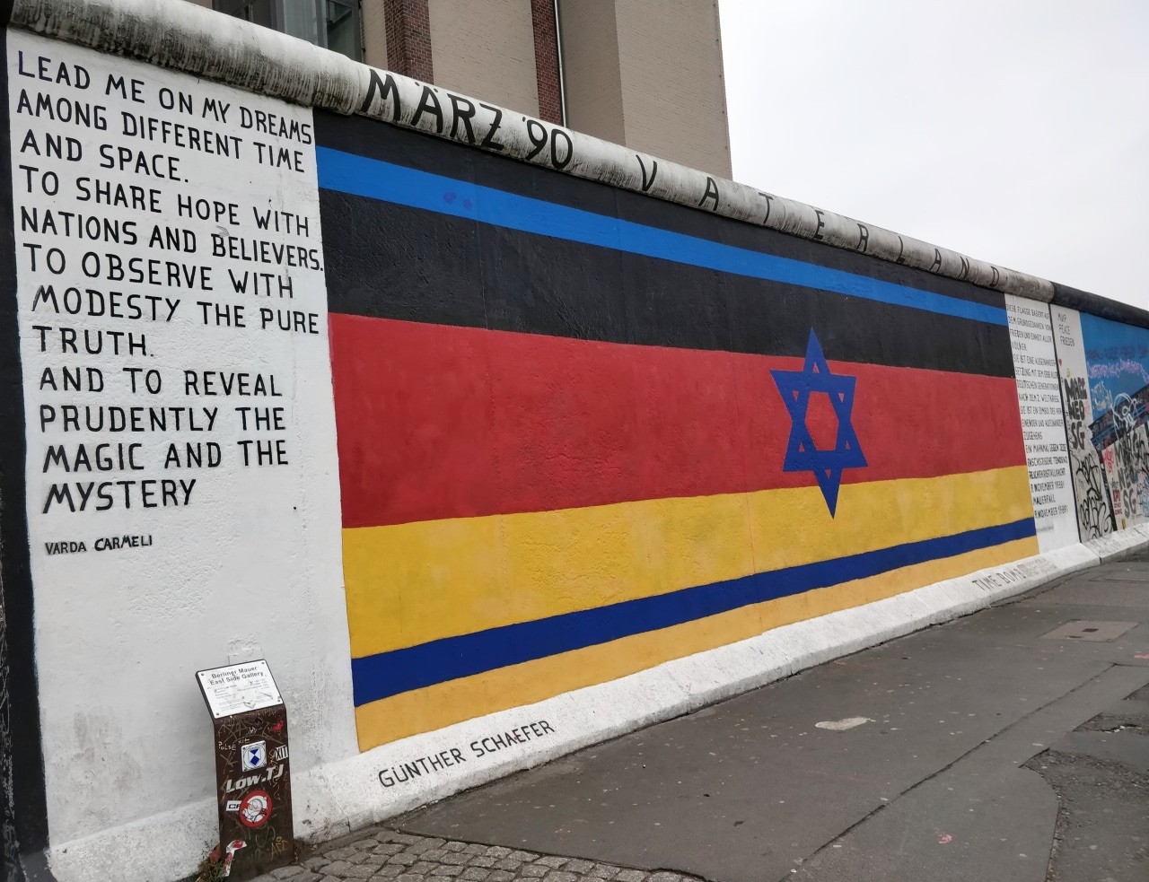 Artist Günther Schaefer fuses German and Israeli flags in this painting to commemorate the traumatic beginning of Fascism and Communism. The flag and its 'pendant painting' were created to honour of the 50th anniversary of the Night of the Broken Glass when Nazi forces in Germany and Austria destroyed Jewish-owned shops. The painting lends itself as a protest against extreme regimes and abuses of human rights.