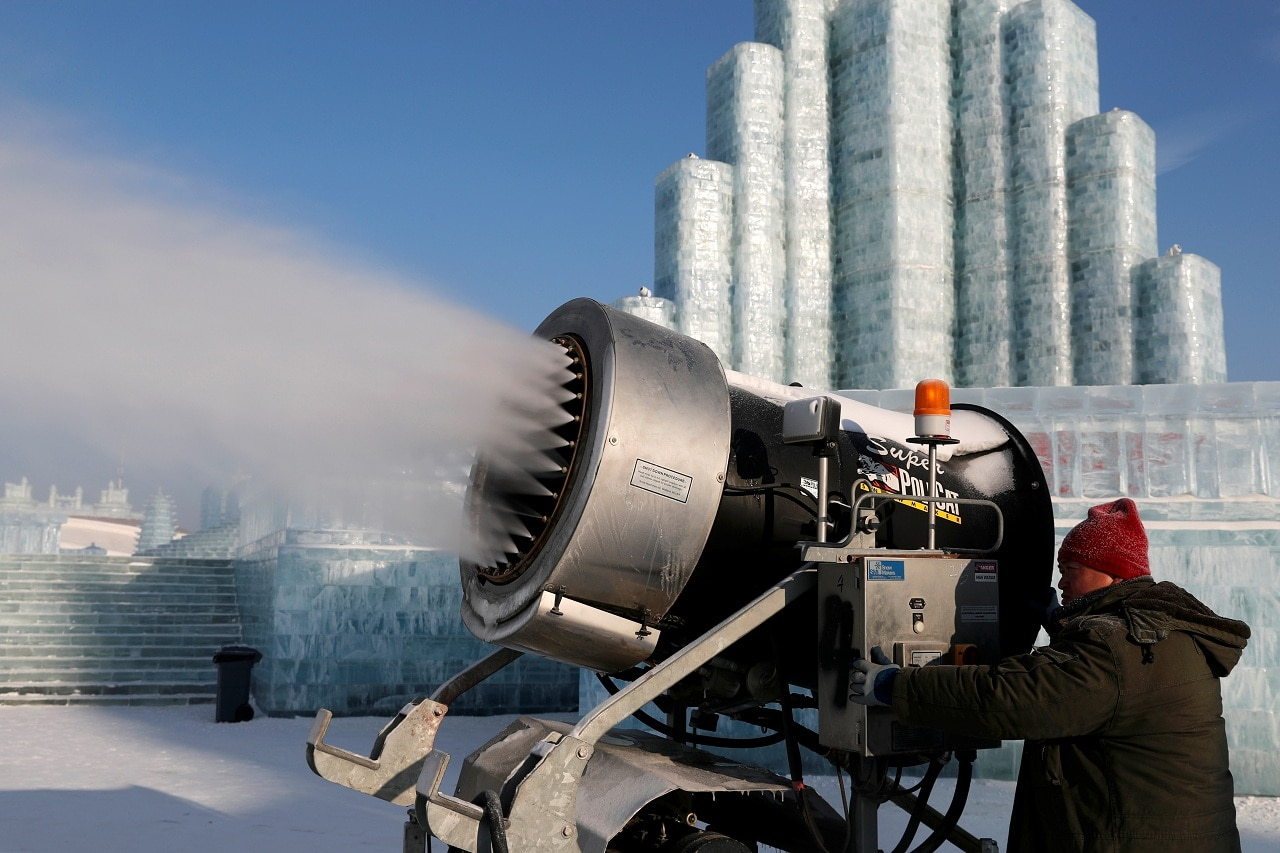 A snowmaking machine sprays artificial snow in front of the ice sculptures during the annual ice festival in Harbin, Heilongjiang province, China January 7, 2019. REUTERS/Tyrone Siu