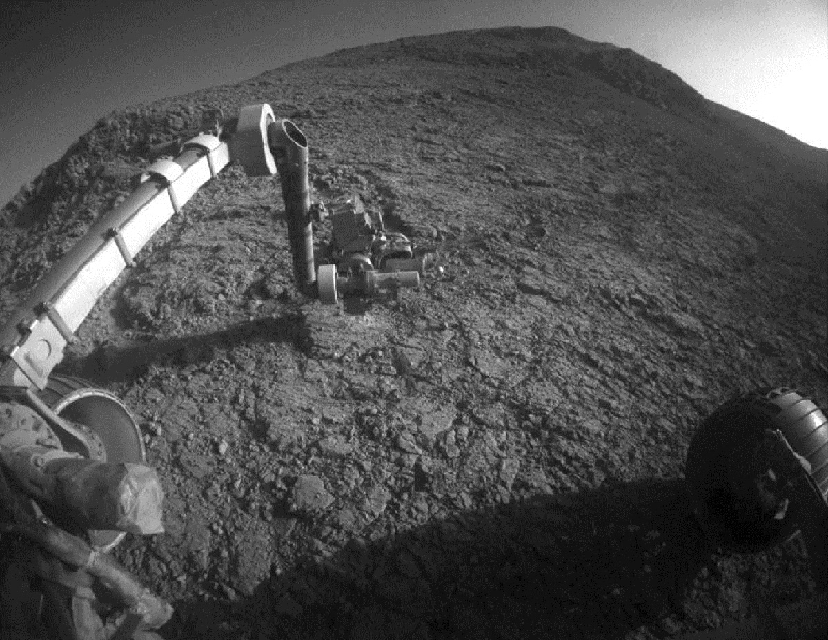 This photo made available by NASA shows the tool turret at the end of the Opportunity rover's robotic arm on the southern side of