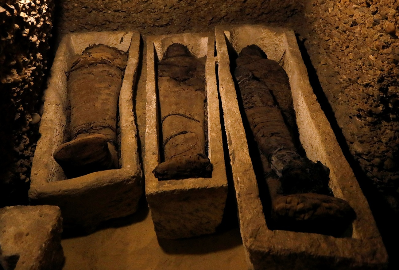 Mummies are seen inside a tomb during the presentation of a new discovery at Tuna el-Gebel archaeological site in Minya Governorate, Egypt. (REUTERS/Amr Abdallah Dalsh)