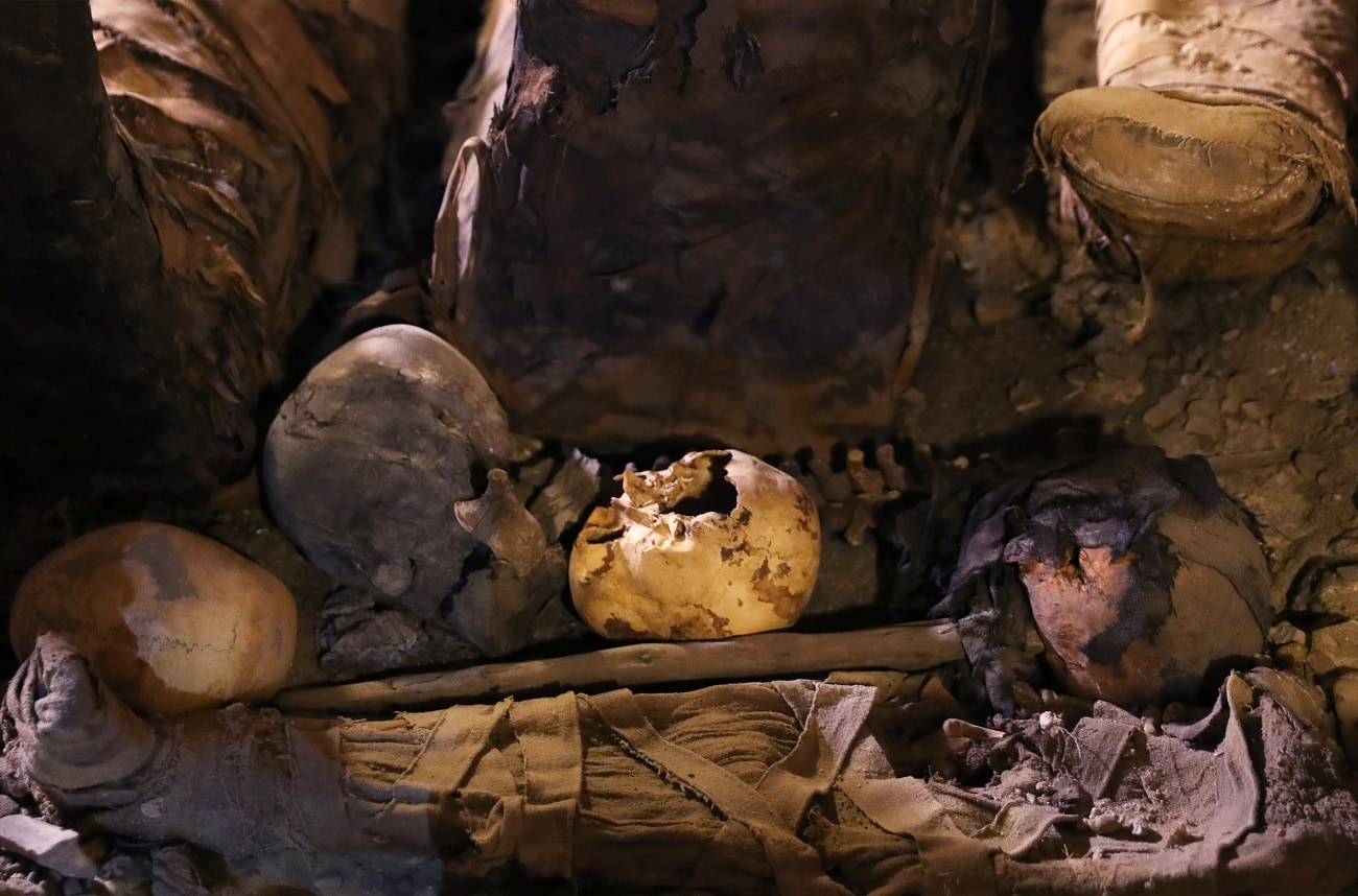 Skulls and bones are seen inside a tomb during the presentation of a new discovery at Tuna el-Gebel archaeological site in Minya Governorate. (REUTERS/Amr Abdallah Dalsh)