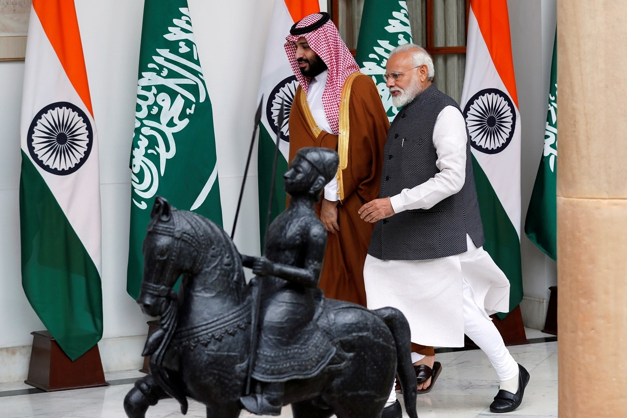 Saudi Arabia's Crown Prince Mohammed bin Salman and India's Prime Minister Narendra Modi arrive ahead of their meeting at Hyderabad House in New Delhi, India, February 20, 2019. (Reuters)
