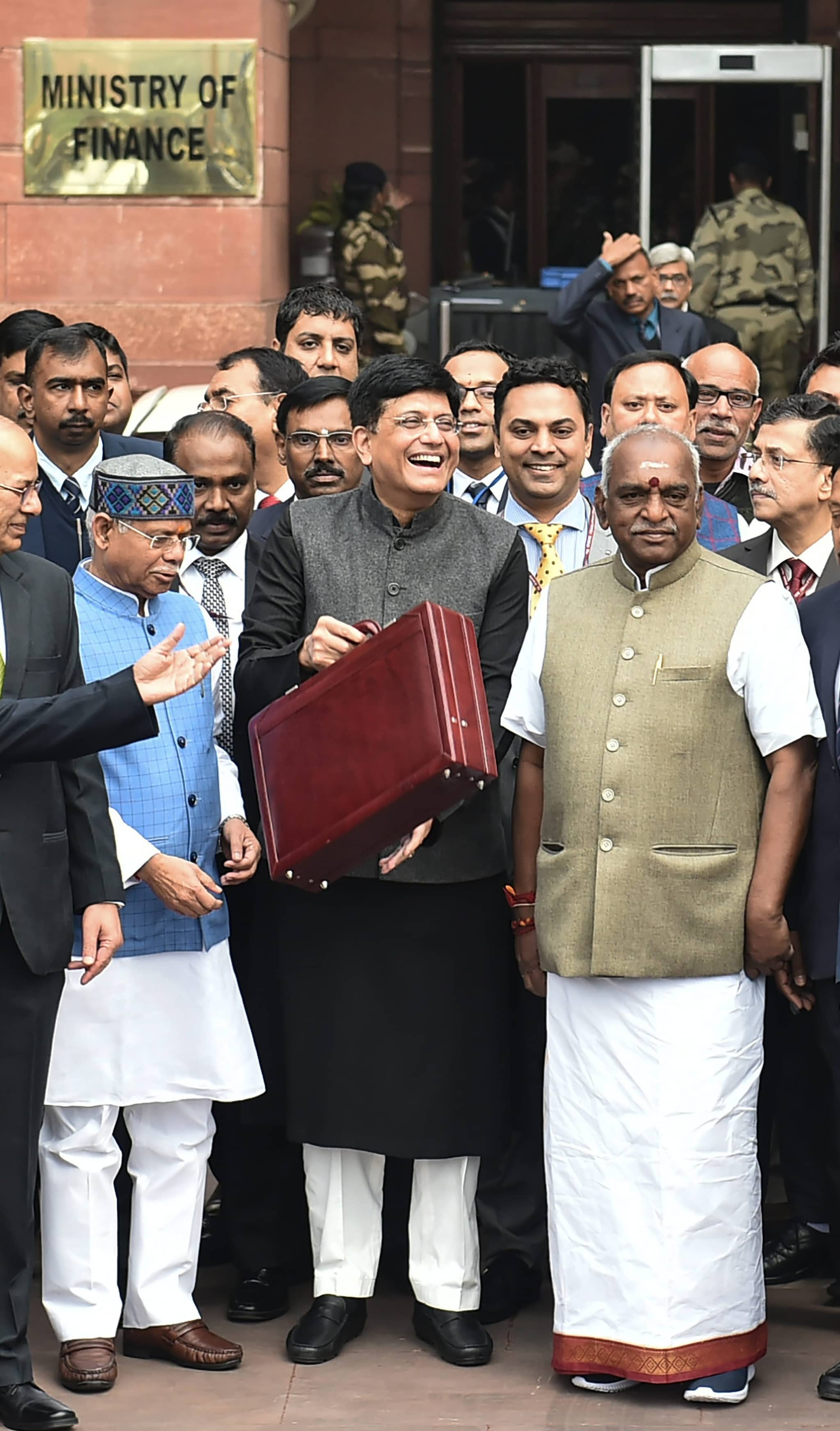 Finance minister Piyush Goyal (C) displays a briefcase containing the Union budget to be presented at the Parliament today, outside his North Block office in New Delhi, Friday,  February 1, 2019. (PTI Photo/ Arun Sharma)