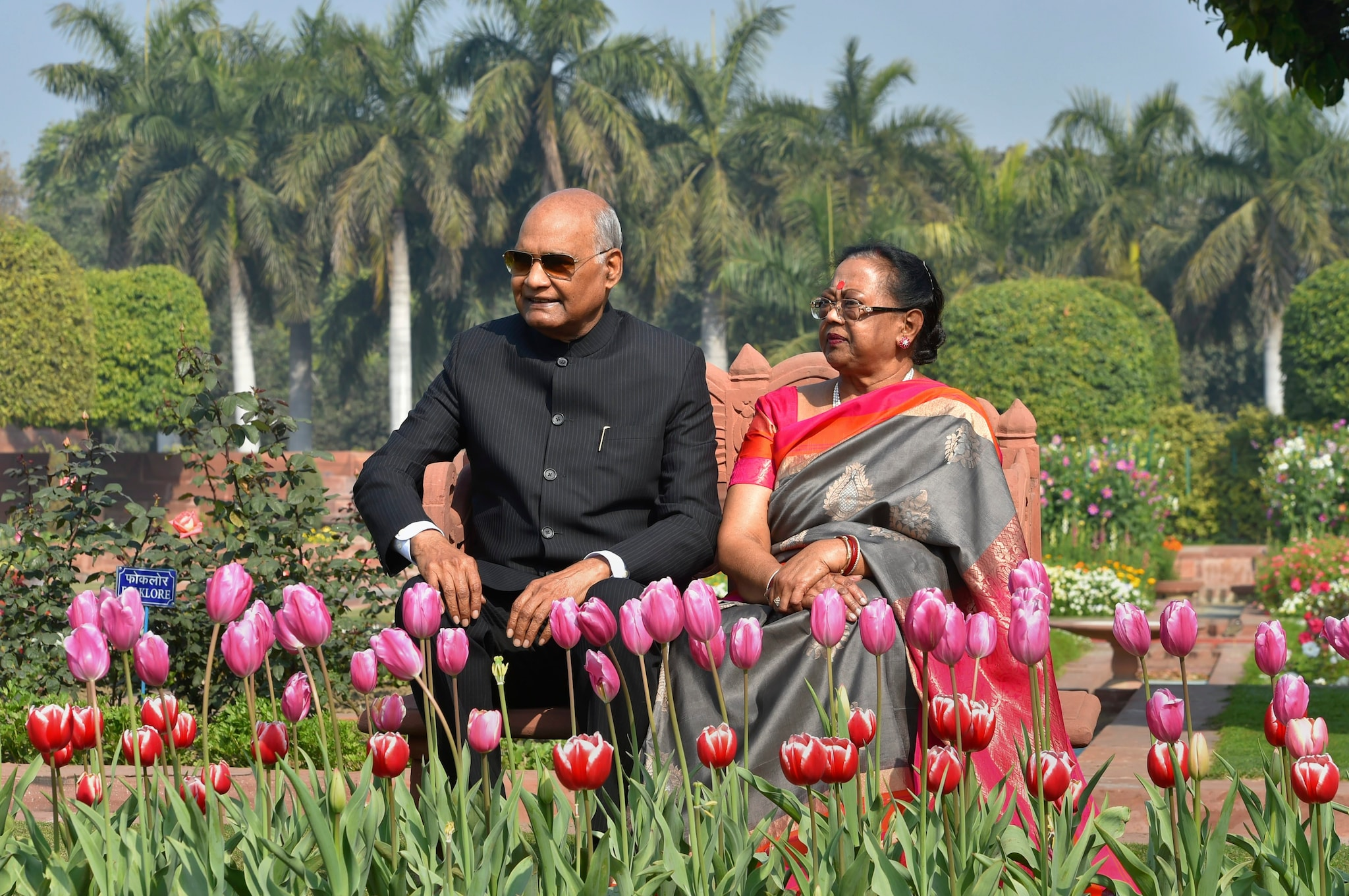 President Ram Nath Kovind and First Lady Savita Kovind sit near a bed of tulips during a preview of the Mughal Gardens at Rashtrapati Bhavan in New Delhi, Monday, Feb. 04, 2019.