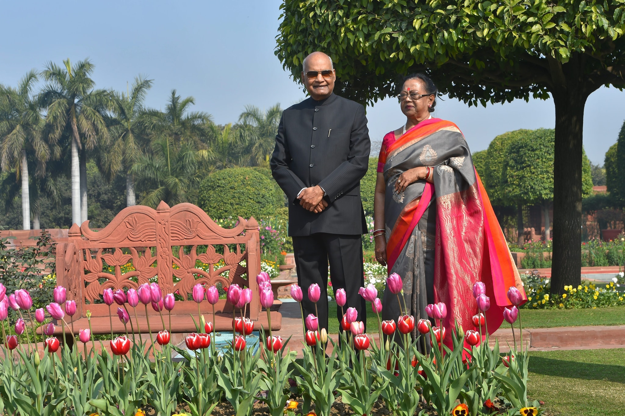 President Ram Nath Kovind and First Lady Savita Kovind pose for a photograph during a preview of the Mughal Gardens at Rashtrapati Bhavan in New Delhi, Monday, Feb. 04, 2019. The Mughal Gardens will open for the general public from Wednesday, Feb. 06 to March 10, 2019.
