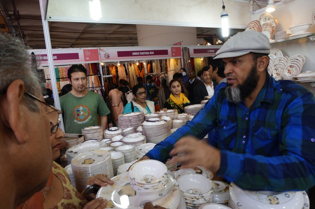 A Pakistani trader selling onyx and porcelain items at a trade fair in India