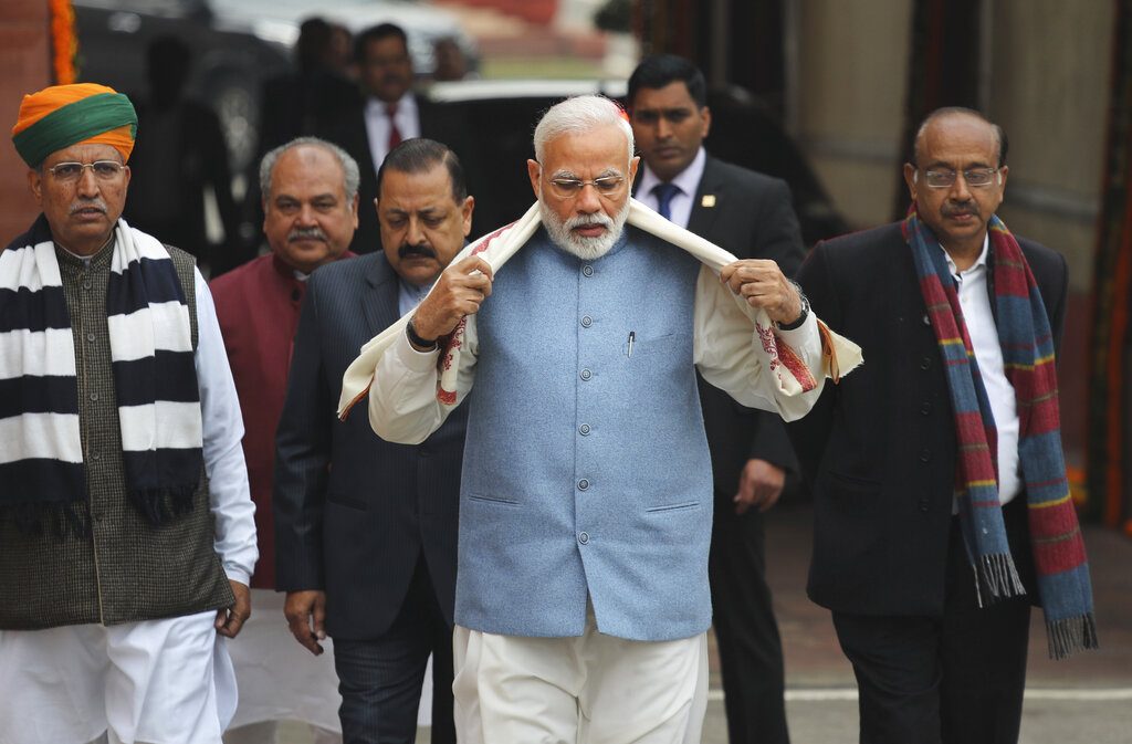 Prime Minister Narendra Modi, center, arrives with his cabinet colleagues on the opening day of the budget session of the Parliament, in New Delhi, India, Thursday, January 31, 2019. (AP Photo/Manish Swarup)