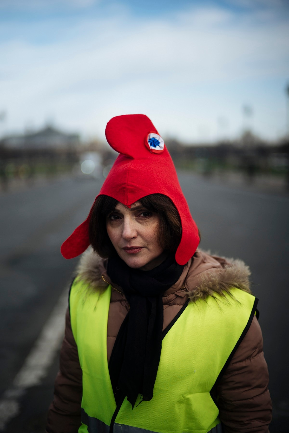 Lara, 45, head of a french company, from Asnieres-sur-Seine, outside of Paris, poses for a portrait with a Marianne hat, symbol of the French Republic. (AP Photo/Kamil Zihnioglu)