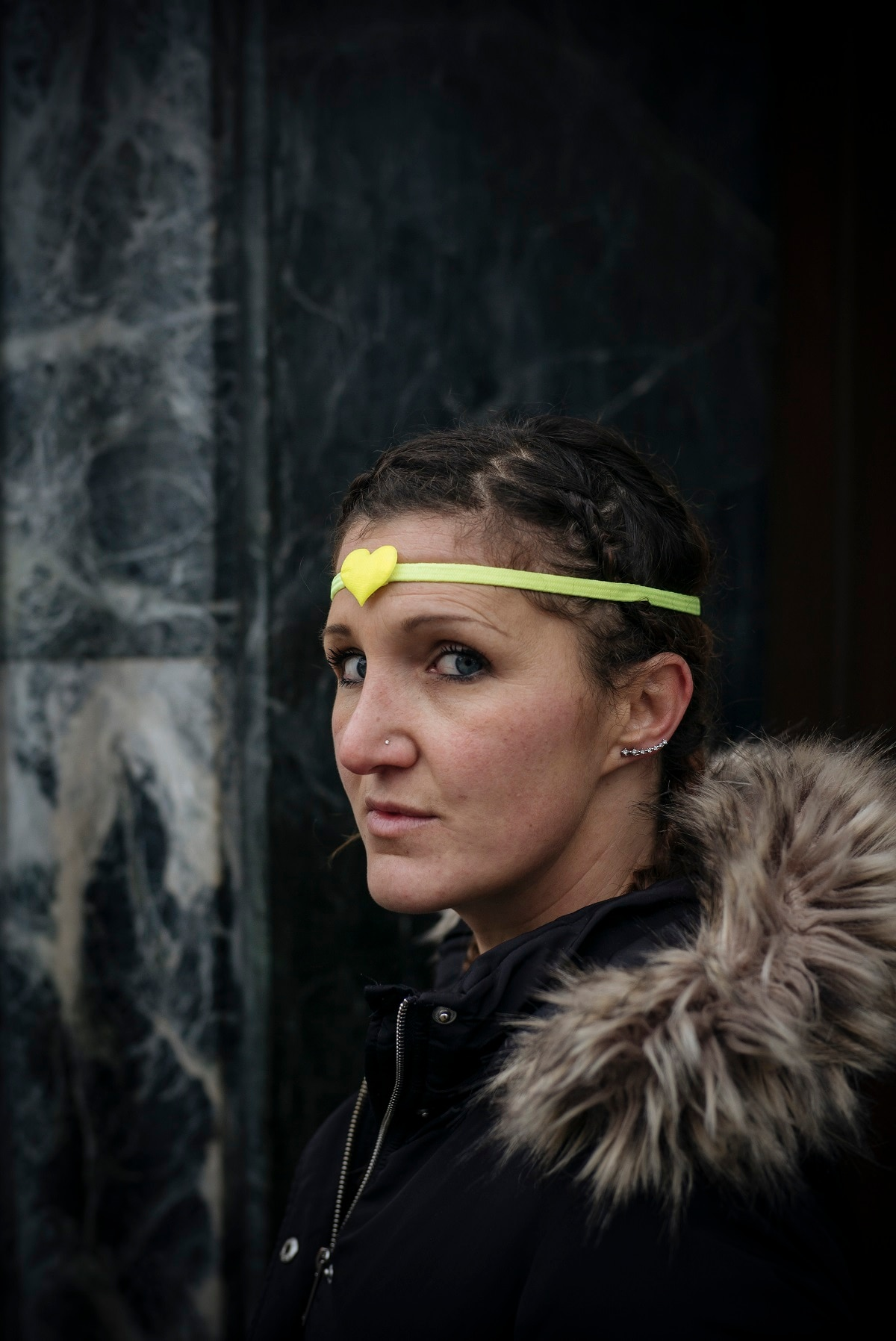 Cecile, 40, personal care assistant, from the Val d'Oise region, north of Paris, poses for a portrait during a demonstration by yellow vest protestors in Paris.(AP Photo/Kamil Zihnioglu)