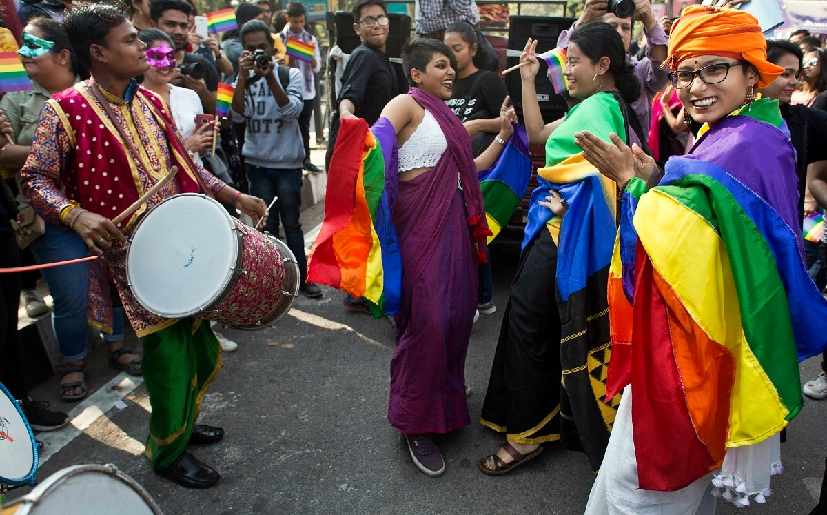 Supporters of the lesbian, gay, bisexual and transgender community dance during the parade. (AP Photo/Anupam Nath)