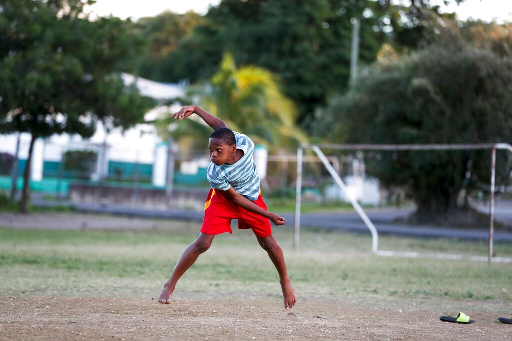 Jewel Andrew plays cricket at a school yard in St. John's , Antigua and Barbuda, Sunday, Feb. 3, 2019, the day after West Indies defeated England for ten wickets in their second Test match. (AP Photo/Ricardo Mazalan)