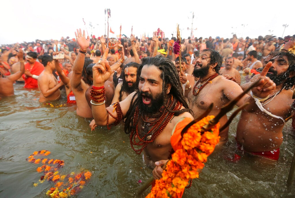 Naga Sadhus take dips at Sangam, the confluence of three sacred rivers the Yamuna, the Ganges and the mythical Saraswati, on Mauni Amavsya or the new moon day, the most auspicious day during the Kumbh Mela or the Pitcher Festival, in Prayagraj, Uttar Pradesh state, India, Monday, February 4, 2019. (AP Photo/Channi Anand)