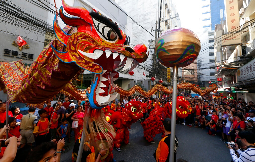 DIn this Tuesday,February 5, 2019, photo, dancers perform traditional lion and dragon dances in celebration of the Lunar New Year in the Chinatown district in Manila, Philippines. (AP Photo/Bullit Marquez)