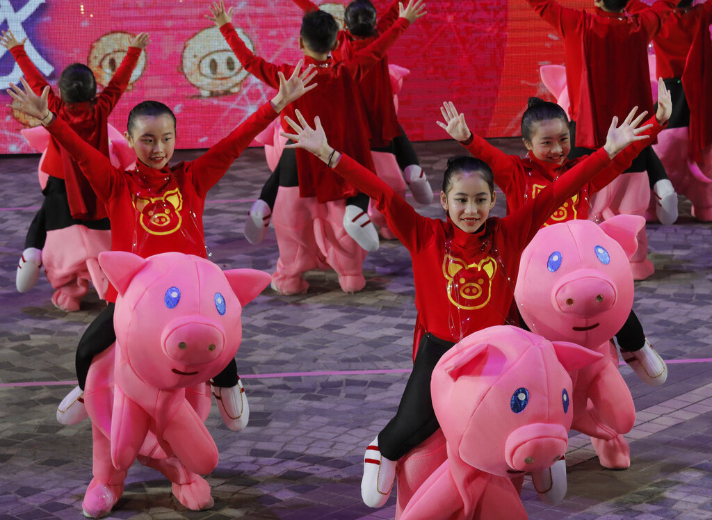 Performers take part in a night parade to celebrate Chinese New Year in Hong Kong, Tuesday, February 5, 2019. The Lunar New Year this year marks the Year of the Pig in the Chinese calendar. (AP Photo/Vincent Yu)