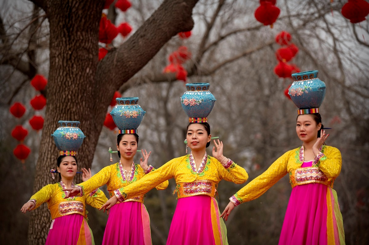 Dancers in traditional ethnic clothing perform at a temple fair at Longtan Park in Beijing. (AP Photo/Mark Schiefelbein, File)