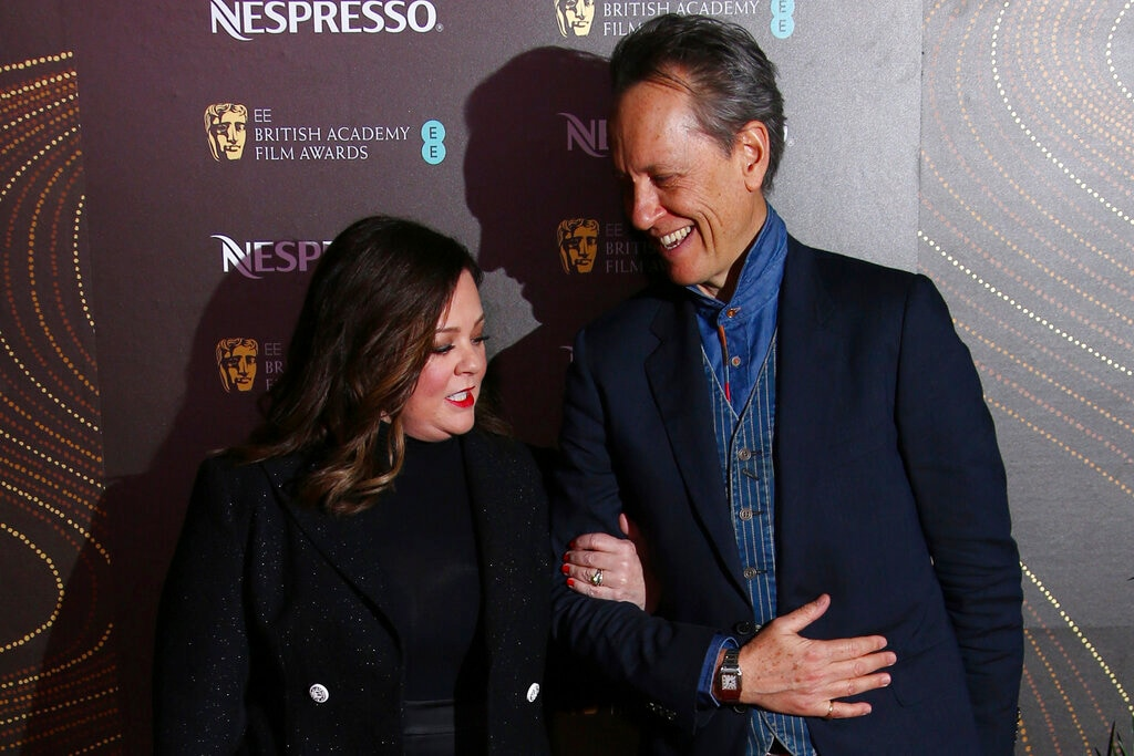 Actors Melissa McCarthy, left, and Richard E. Grant pose for photographers upon arrival at the BAFTA Nominees Party in London, Saturday, February 9, 2019. (AP)