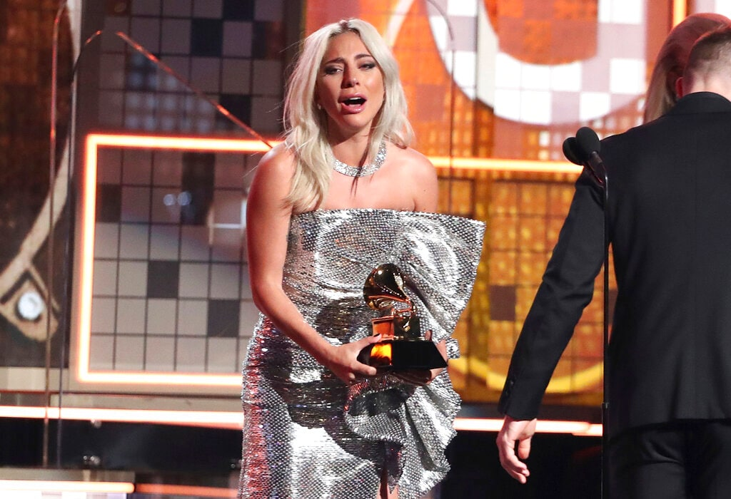 Lady Gaga reacts before accepting the award for best pop duo or group performance for
