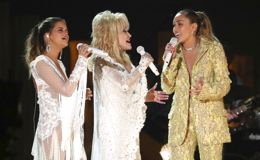 Maren Morris, from left, Dolly Parton and Miley Cyrus perform