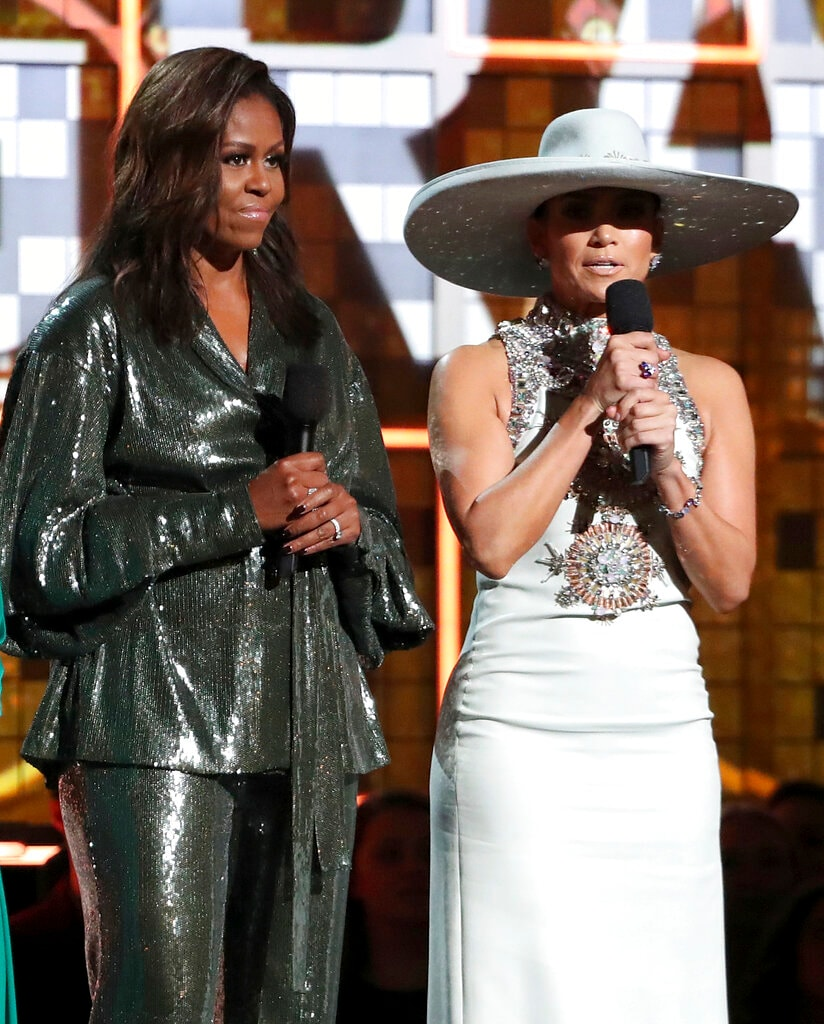 Michelle Obama, left, and Jennifer Lopez speak at the 61st annual Grammy Awards on Sunday, February 10, 2019, in Los Angeles. (Photo by Matt Sayles/Invision/AP)