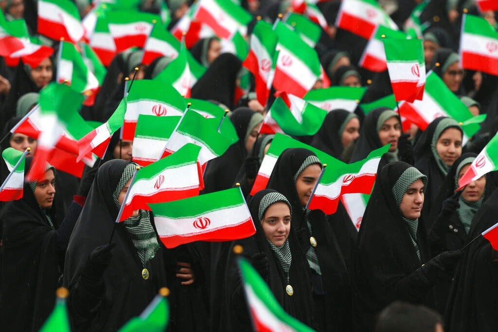 Iranians wave national flags during a ceremony celebrating the 40th anniversary of the Islamic Revolution, at the Azadi, or Freedom, Square, in Tehran, Iran, Monday, February 11, 2019. (AP Photo/Vahid Salemi)