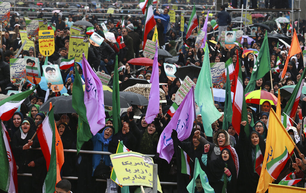 Demonstrators chant slogan in a ceremony celebrating the 40th anniversary of the Islamic Revolution, at the Azadi, Freedom, Square in Tehran, Iran, Monday, February 11, 2019. (AP Photo/Vahid Salemi)
