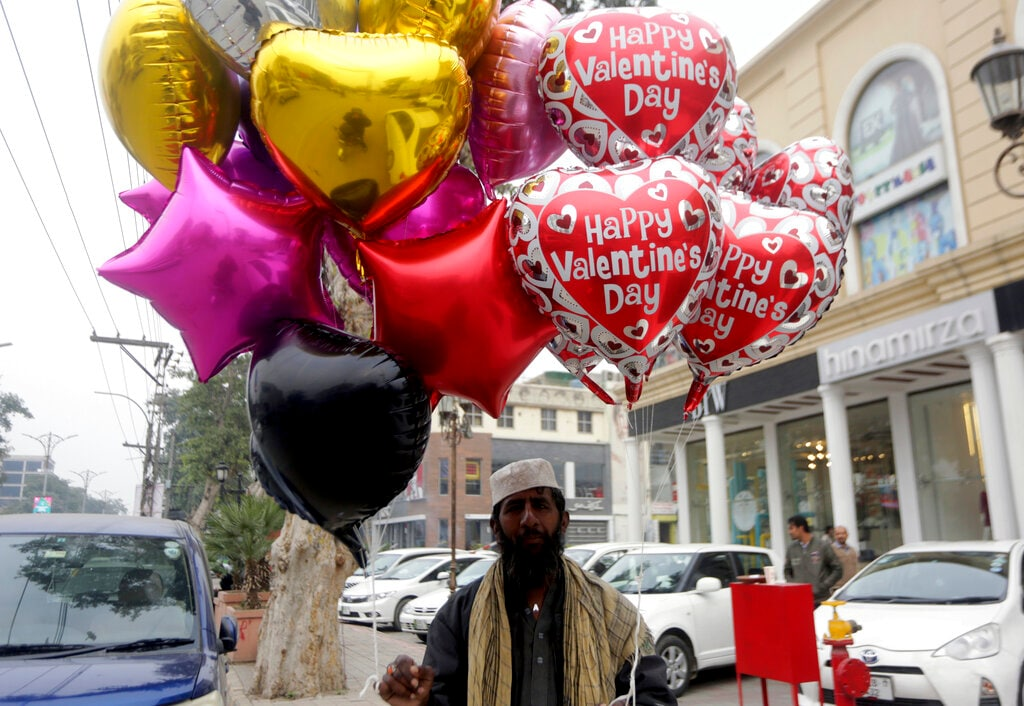 A Pakistani vendor waits for customers to sell balloons ahead of Valentine's Day in Lahore, Pakistan, Wednesday, February 13, 2019. (AP Photo/K.M. Chaudary)