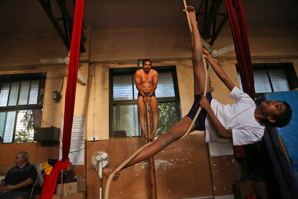 In this February 5, 2019, photo, mallakhamb players perform on a pole and rope at the Shree Samartha Vyayam Mandir at Shivaji Park in Mumbai, India. (AP Photo/Rafiq Maqbool)