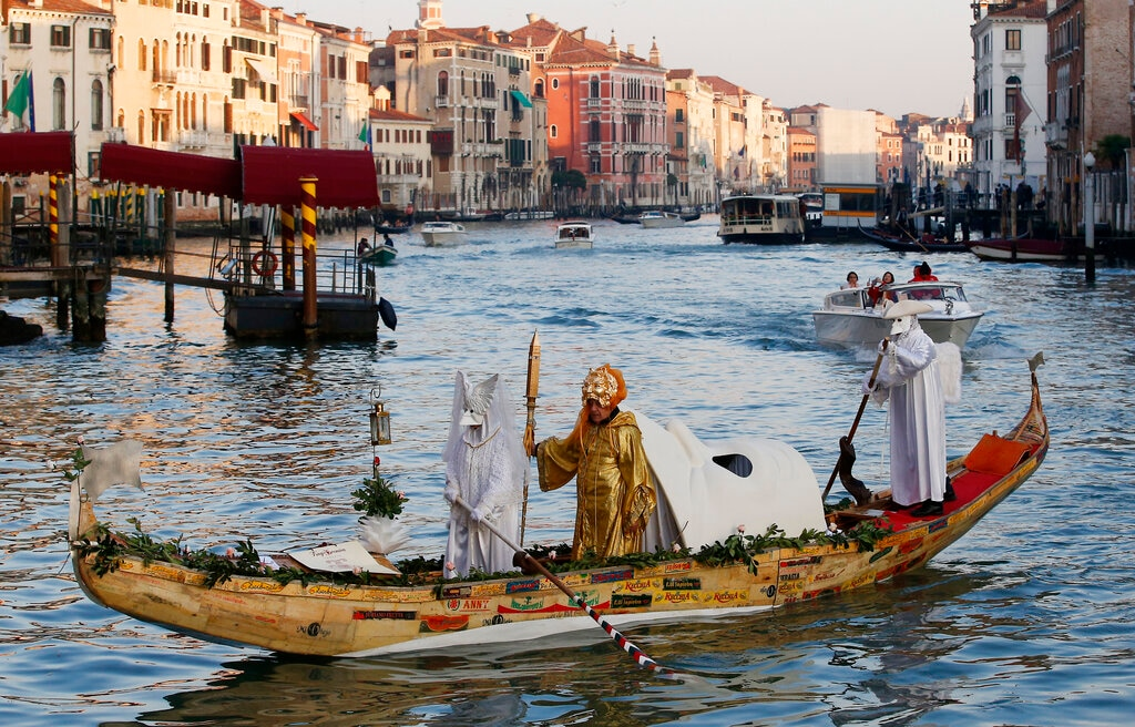 Masked people stand on a gondola as part of the Carnival in Venice, Italy, Saturday, February 16, 2019. (AP Photo/Antonio Calanni)