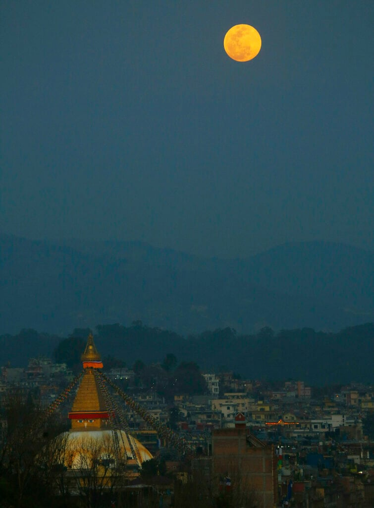 A full moon is seen rising behind the Boudhanath Stupa in Kathmandu, Nepal, Tuesday, Feb. 19, 2019. (AP)