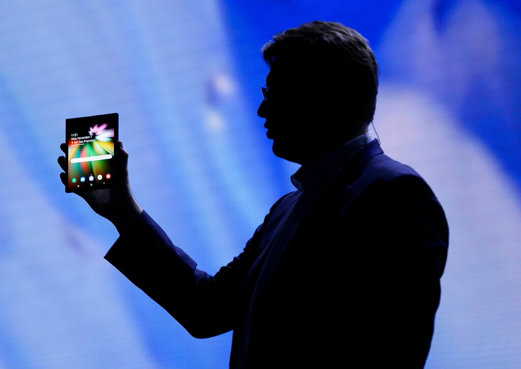In this November 7, 2018 file photo, Justin Denison, SVP of Mobile Product Development, shows off the Infinity Flex Display of a folding smartphone during the keynote address of the Samsung Developer Conference, in San Francisco. (AP Photo/Eric Risberg, File)
