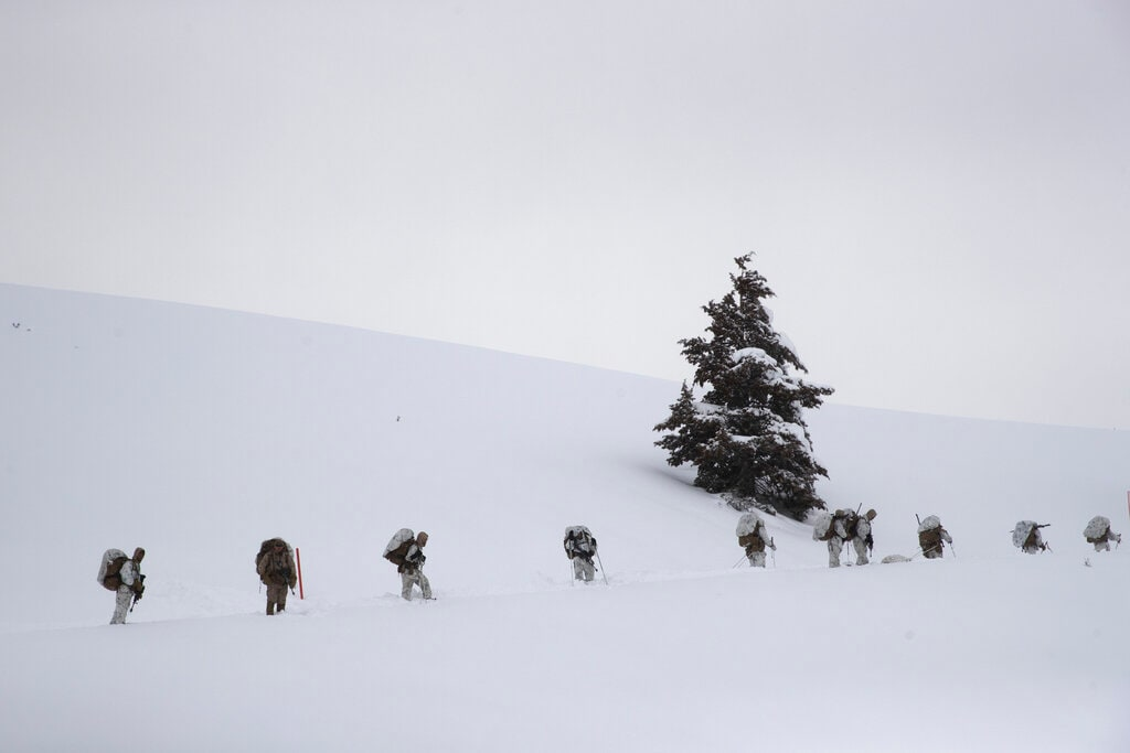 A group of US Marines walks along a snow-covered trail during advanced cold-weather training at the Marine Corps Mountain Warfare Training Center on Sunday, February 10, 2019, in Bridgeport, California. After 17 years of war against Taliban and al-Qaida-linked insurgents, the military is shifting its focus to better prepare for great-power competition with Russia and China, and against unpredictable foes such as North Korea and Iran. (AP)