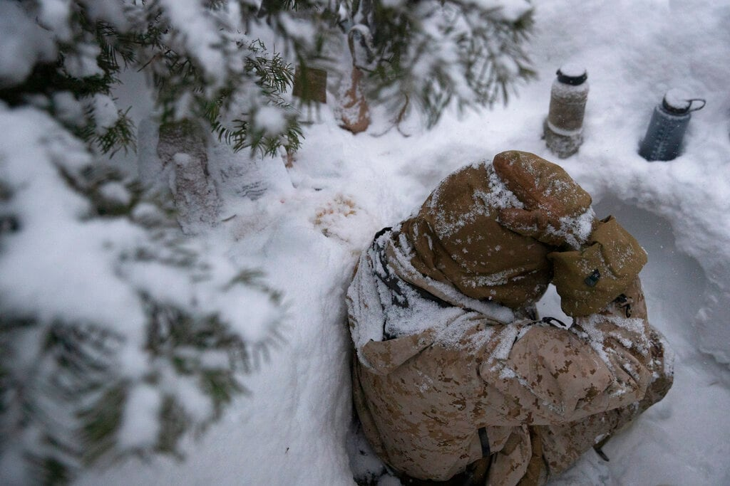 A US Marine sits in a trench during advanced cold-weather training at the Marine Corps Mountain Warfare Training Center Saturday, February 9, 2019, in Bridgeport. (AP)