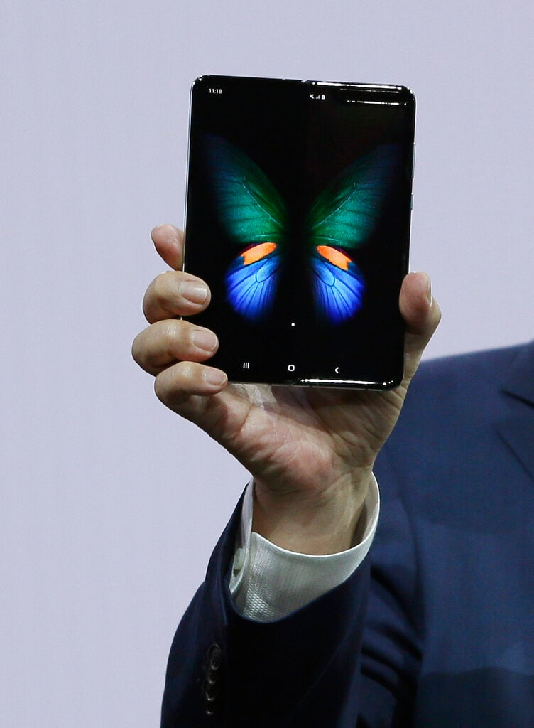 DJ Koh, Samsung President and CEO of IT and Mobile Communications, holds up the new Galaxy Fold smartphone during an event Wednesday, February 20, 2019, in San Francisco. (AP Photo/Eric Risberg)