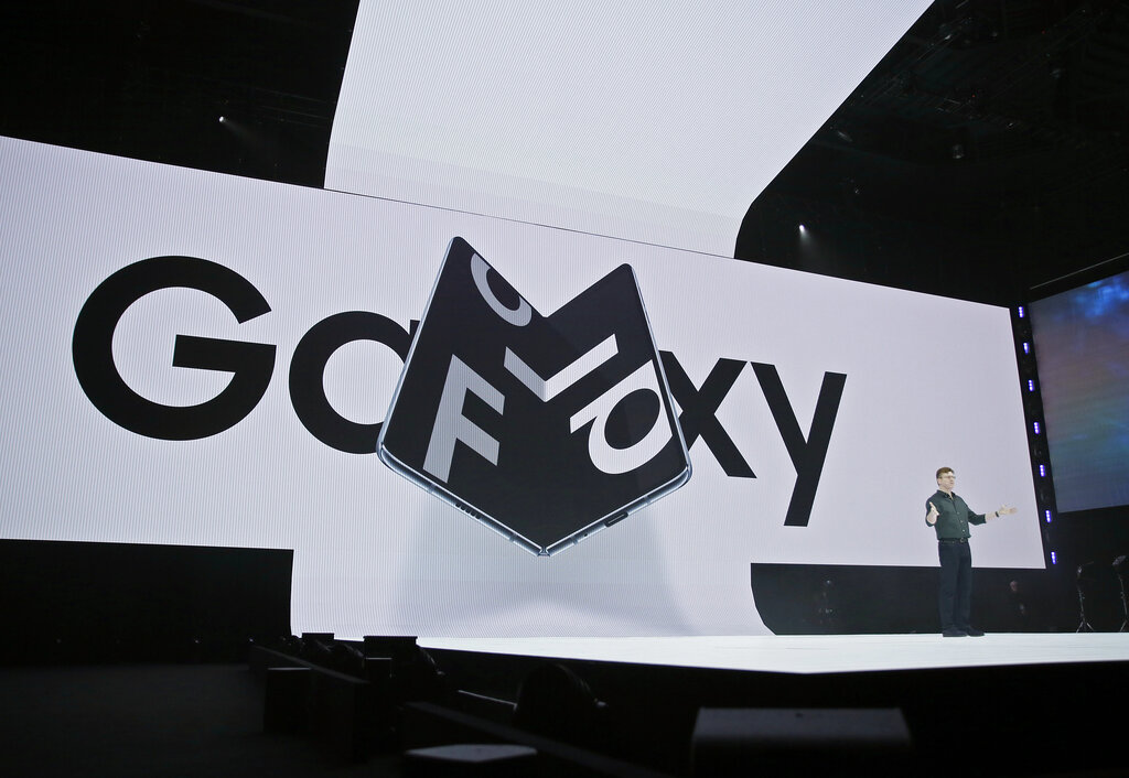 With the foldable phone, Samsung is going on the offence on two fronts in the smartphone race: It is offering an eye-catching new feature with the big, bending screen and the first 5G connection in a premium phone, a feature analysts do not expect Apple to match until 2020. (AP Photo/Eric Risberg)