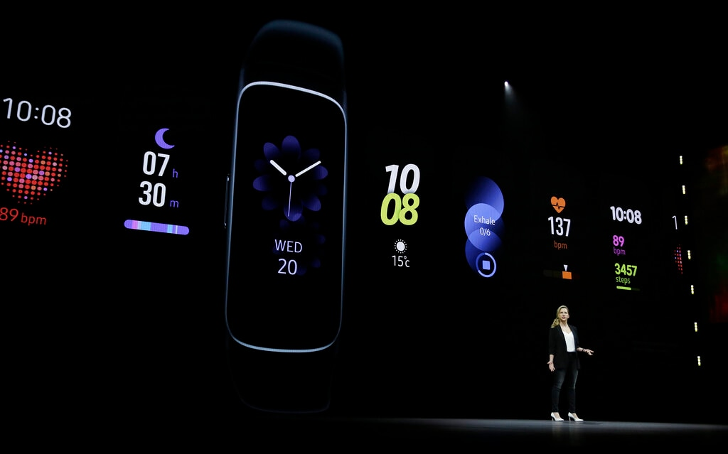 Elina Vives, Senior Director of Marketing, talks about the new Samsung Galaxy Active and Fit watches during an event Wednesday, February 20, 2019, in San Francisco. (AP Photo/Eric Risberg)