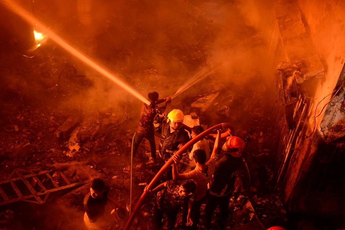 Firefighters try to douse flames in Dhaka, Bangladesh. (AP Photo/Mahmud Hossain Opu)