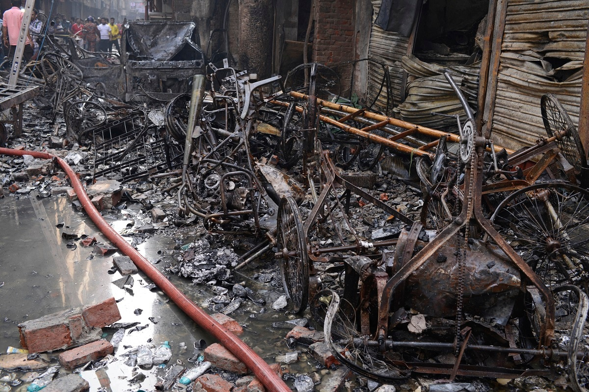 The wrangled and charred remains of rickshaws lie at the site of the late Wednesday night fire in Dhaka. (AP Photo/Mahmud Hossain Opu )