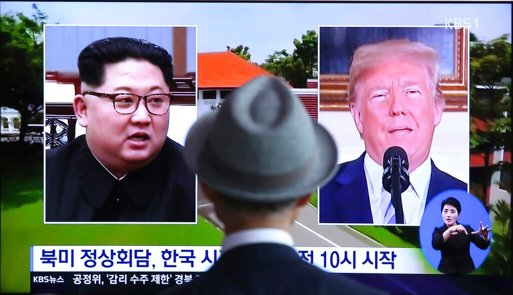 In this June 11, 2018, file photo, a man watches a TV screen showing file footage of US President Donald Trump, right, and North Korean leader Kim Jong Un during a news program at the Seoul Railway Station in Seoul, South Korea. (AP Photo/Ahn Young-joon, File)