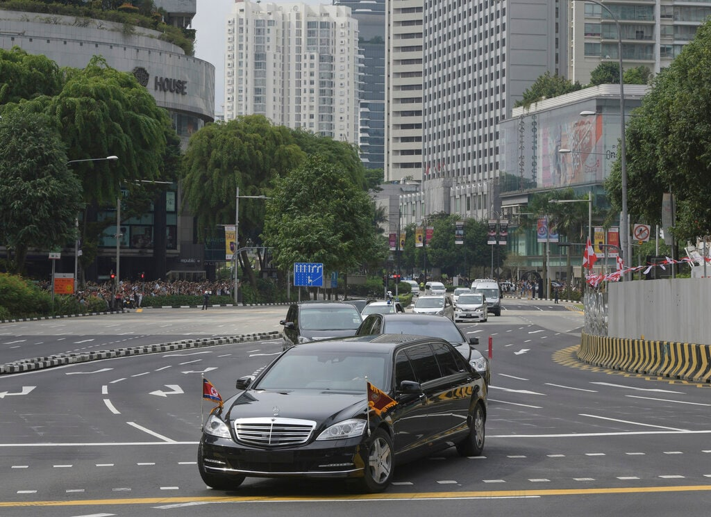 In this June 10, 2018, file photo, the North Korean Motorcade believed to be carrying Kim Jong Un travels past Singapore's Orchard Road on its way to the St Regis Hotel ahead of the first summit with US President Donald Trump. (AP Photo/Joseph Nair, File)