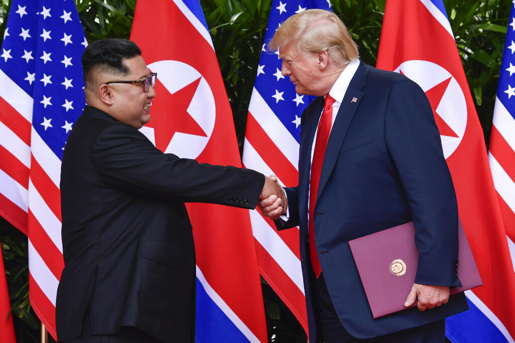 In this June 12, 2018, file photo, North Korea leader Kim Jong Un and U.S. President Donald Trump shake hands at the conclusion of their meetings at the Capella resort on Sentosa Island in Singapore. (AP Photo/Susan Walsh, Pool, File)