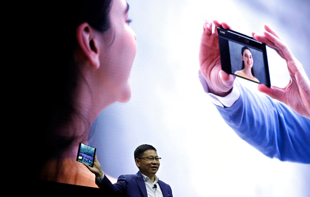 Huawei CEO Richard Yu displays the new Huawei Mate X foldable 5G smartphone at the Mobile World Congress, in Barcelona, Spain, Sunday, February 24, 2019. The fair started with press conferences on Sunday, before the doors open on Monday, February 25, and runs until February 28. (AP Photo/Manu Fernandez)