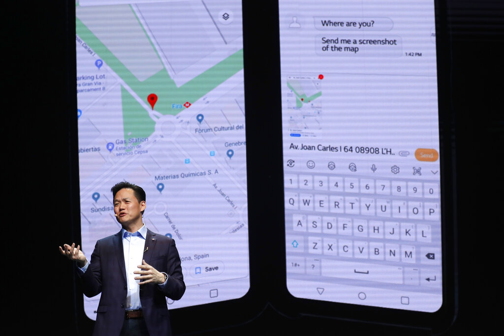 Frank Lee of LG Electronics gestures during the presentation of the new LG V50 ThinQ 5G smartphone with clip on second screen at the Mobile World Congress, in Barcelona, Spain, Sunday, Feb. 24, 2019. The fair started with press conferences on Sunday, before the doors open on Monday, Feb. 25, and runs until Feb. 28. (AP Photo/Manu Fernandez)
