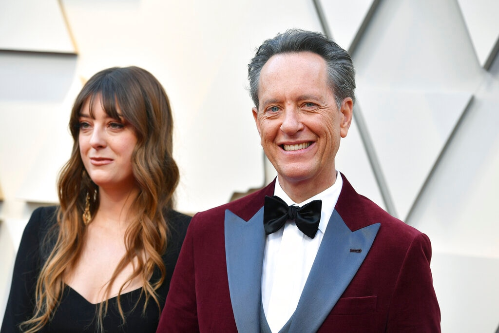 Olivia Grant, left, and Richard E. Grant arrive at the Oscars on Sunday, February 24, 2019, at the Dolby Theatre in Los Angeles. (Photo by Jordan Strauss/Invision/AP)