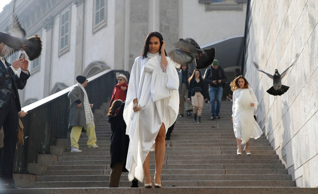 In this picture taken on Tuesday, February 19, 2019, fashion influencer Virginia Stablum, leaves after the Alberto Zambelli women's Fall-Winter 2019-2020 fashion show, that was presented in Milan, Italy. (AP Photo/Luca Bruno)