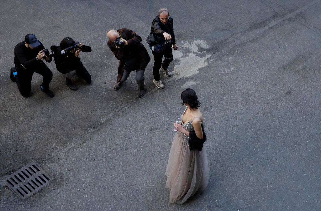 In this picture taken on Friday, February 22, 2019, a blogger arrives to attend the Iceberg women's Fall-Winter 2019-2020 fashion show, that was presented in Milan, Italy, Friday, February 22, 2019. (AP Photo/Luca Bruno)