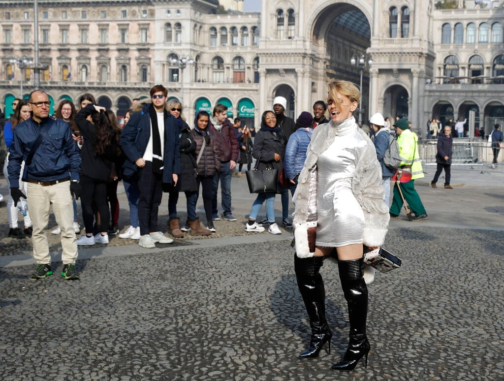 In this picture taken on Tuesday, February 19, 2019, Italian showgirl Justine Matera poses for photographers after the Alberto Zambelli women's Fall-Winter 2019-2020 fashion show, that was presented in Milan, Italy. (AP Photo/Luca Bruno)