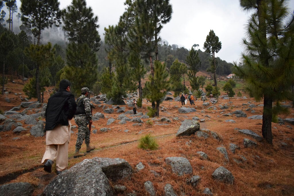 Pakistani reporters and troops visit the site of an Indian airstrike in Jaba, near Balakot, Pakistan, Tuesday, Feb. 26, 2019.  (AP Photo/Aqeel Ahmed)